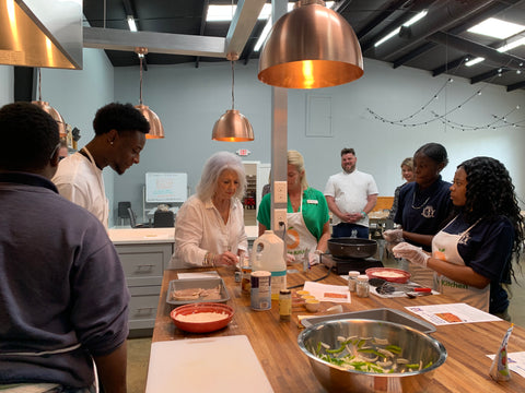 Paula Deen Helping in Full Circle Kitchen