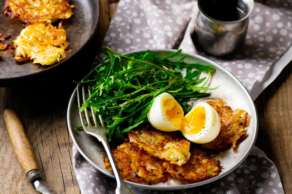 eggs with potato rosti and rocket