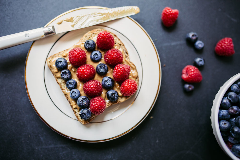 peanut butter and berries on toast