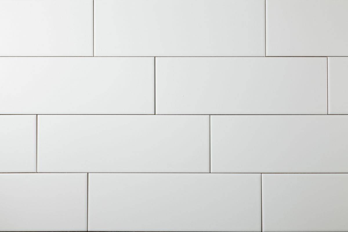 White Subway Tiles And Black Kitchen