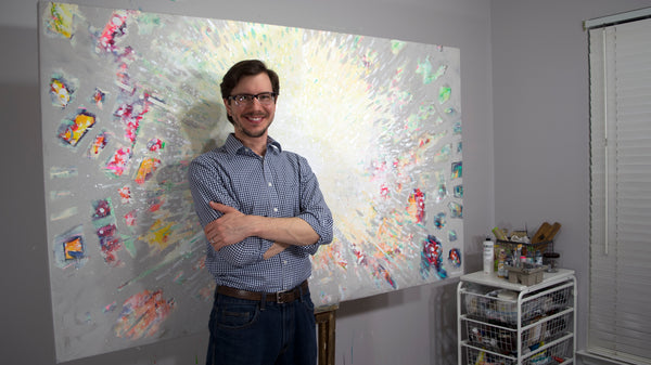 Stephen Lursen in front of his finished abstract painting