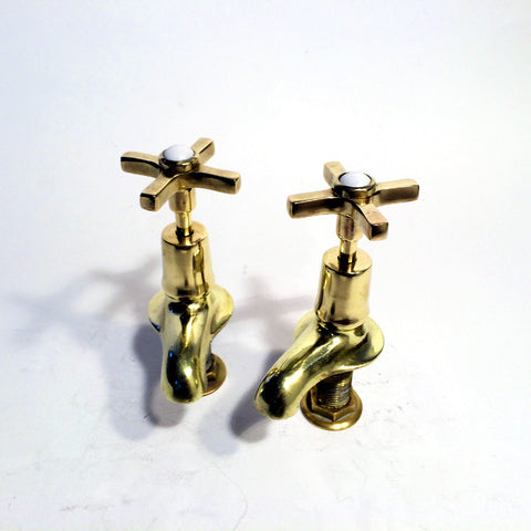 Edwardian skirted basin taps
