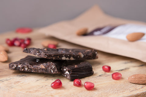 Dark chocolate infused with tangy pomegranate molasses, roasted almonds and sun dried pomegranate fruit