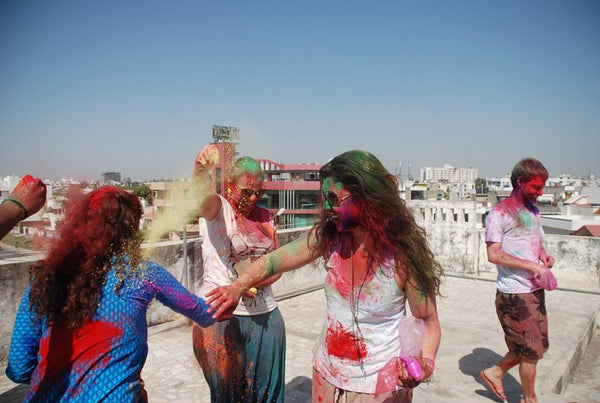 foreign girls playing Holi