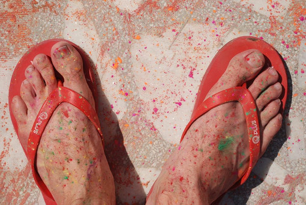 rubber flip flops stained with Holi colors