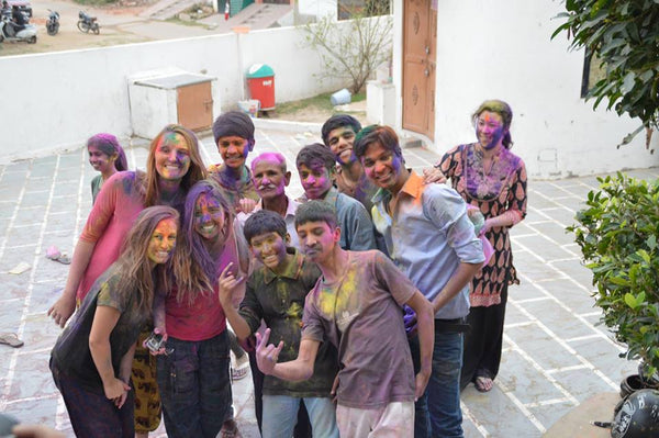 foreigners playing holi with indian children