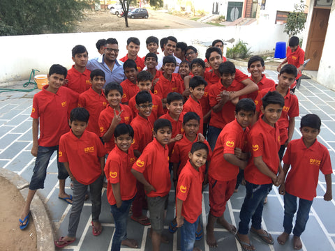 Indian boys wearing red t shirt