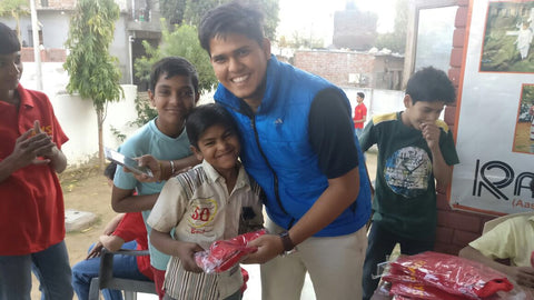 Peeyush Rastogi with child from NGO