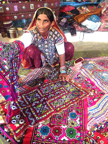 Indian artisan selling hand made cloth