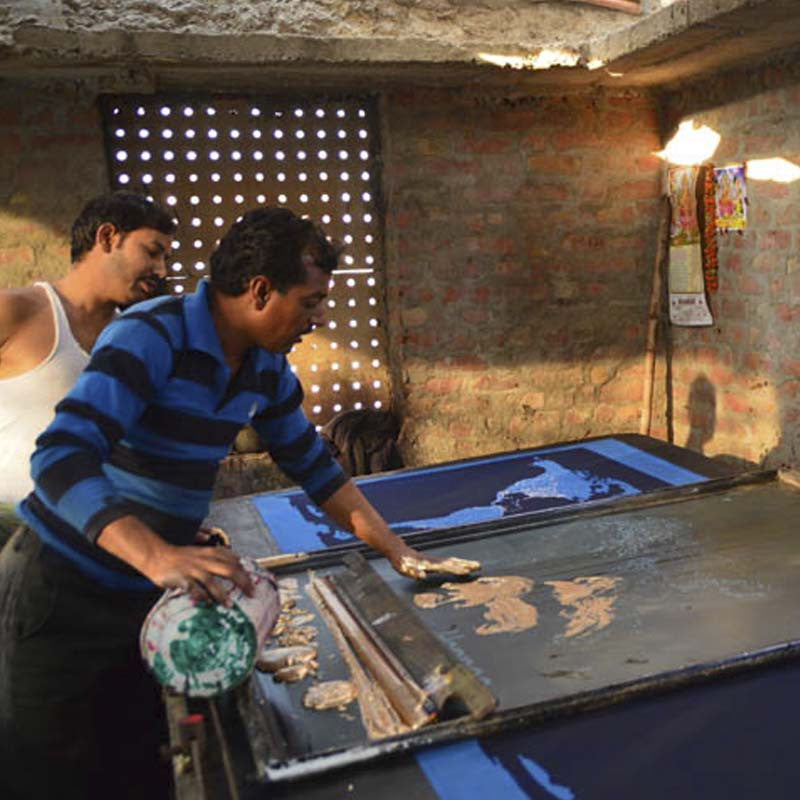 Indian artisans working with printing