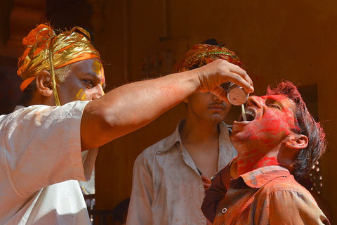 indian boy having bhang during holi