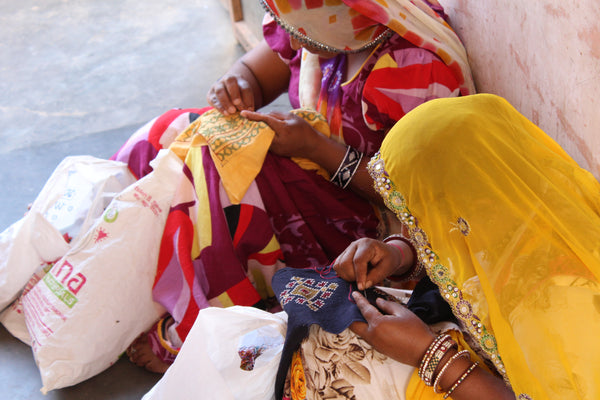 Indian artisans making embroidery