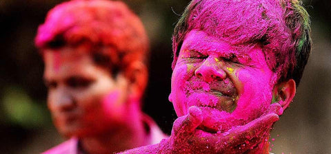 indian boy playing Holi