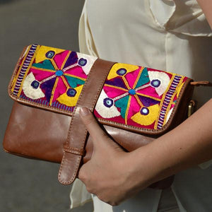 Hand embroidered leather clutch