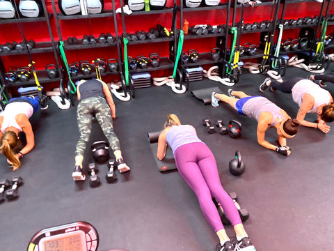 women in gym after wls