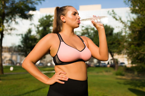 Plus-size-woman-hydrating-water