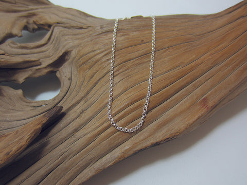 A nice sturdy, sterling silver chain which works well with heavier pendants, also works well if you're looking for a longer chain. It is 2.25mm wide. 925 Silver Canterbury