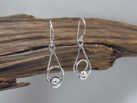 caged bead drops. Nice curves - these sterling silver earrings are 20mm long