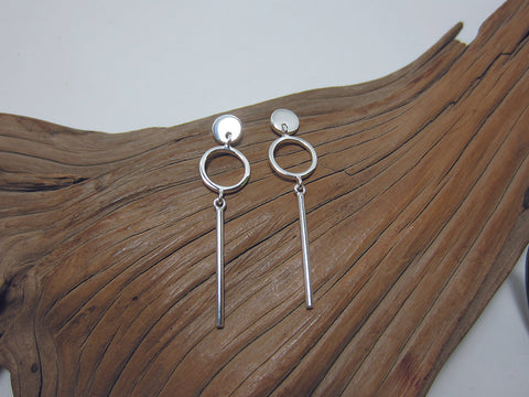 Simple and stylish sterling silver geometric drop earrings. They are 40mm long and have a post and butterfly fitting.