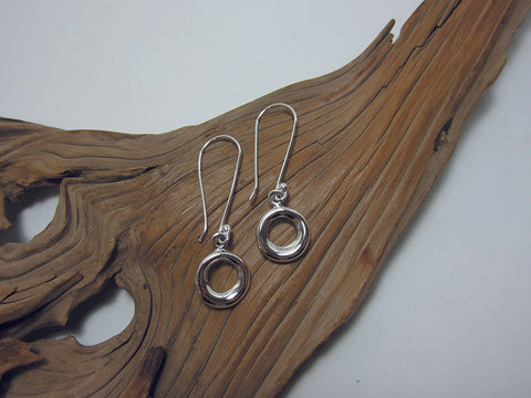 A 15mm diameter 'doughnut' hangs from a longer than usual hook. The hooks are 35mm long so the overall earring measures 52mm long. Sterling silver 925 Canterbury