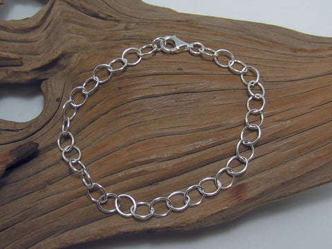 "Very simple sterling silver oval link bracelet which could be used with charms. 7.5"" inches long. 925 Silver Canterbury"