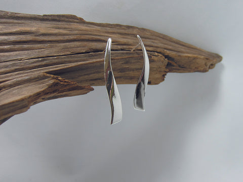 These sterling silver earrings have a flowing ribbon feel to them, they are 40mm long and 5mm wide.