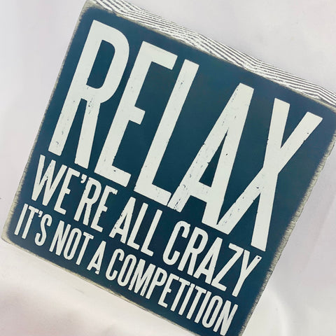 Relax We're All Crazy Box Sign
