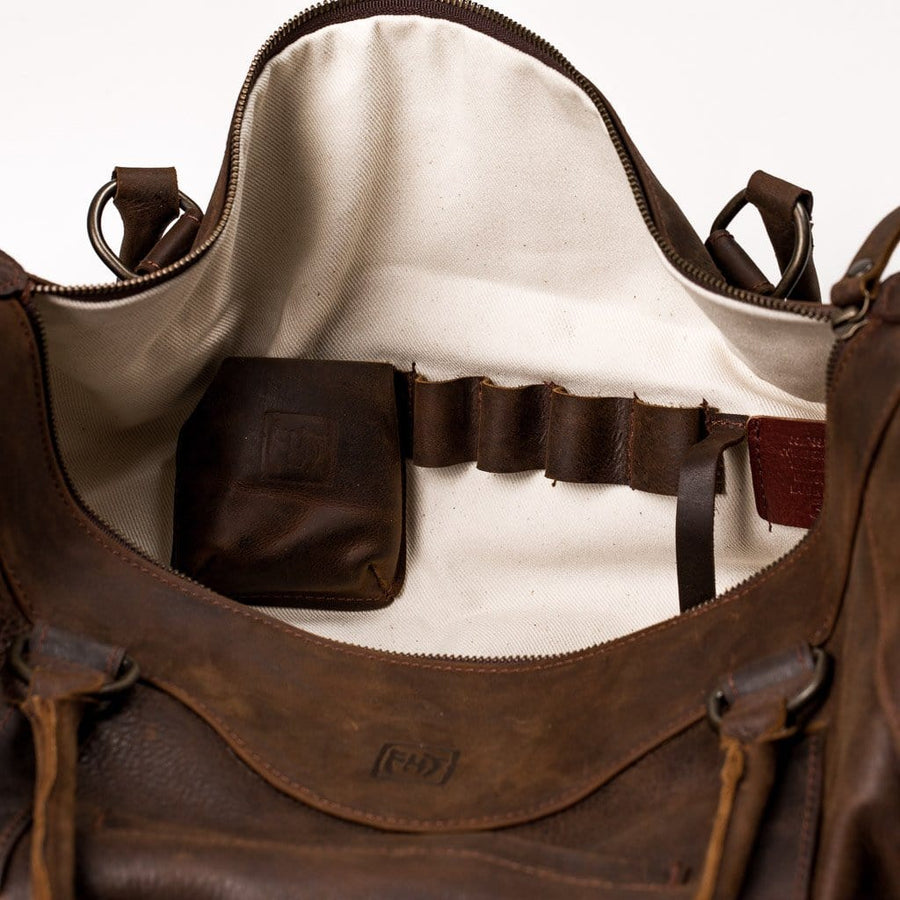 Cow Hide Bag: Voyager Duffle Far Horizon Traders