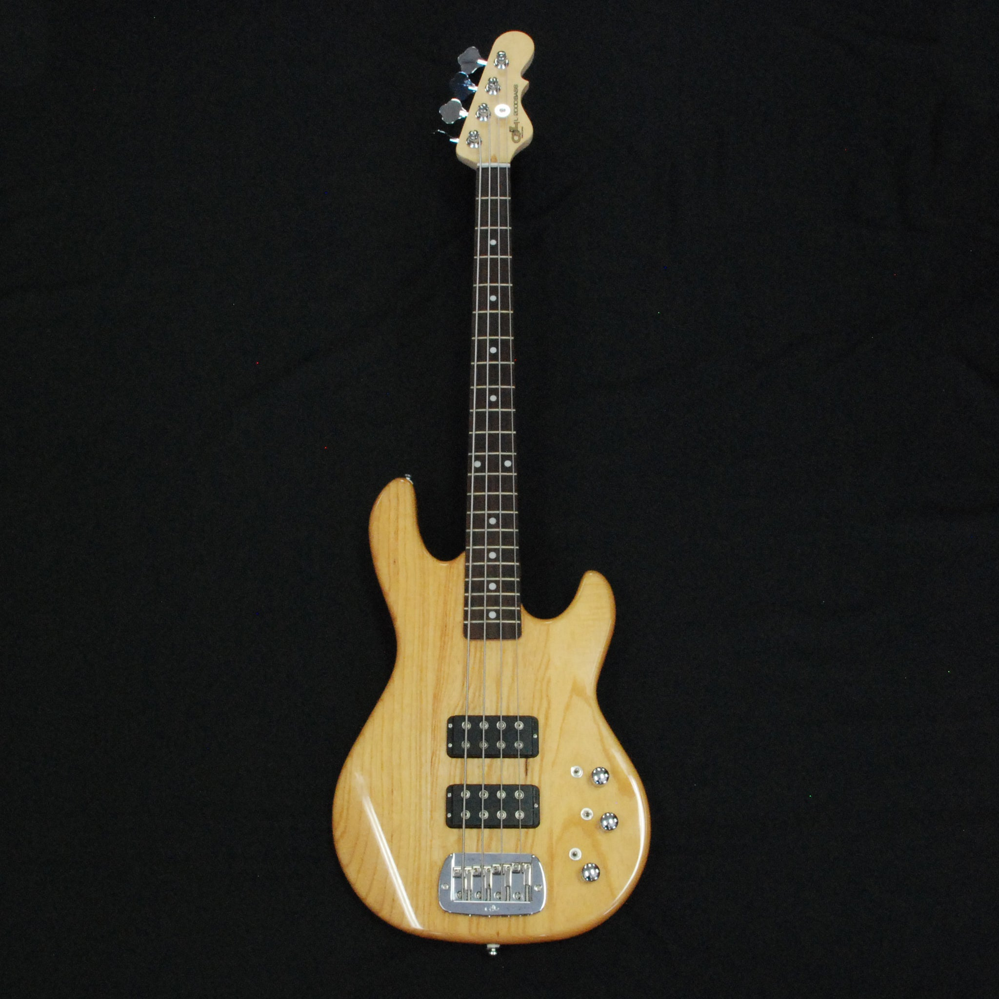 Shop online for G&L Tribute L2000 4 String Electric Bass Guitar Natural Ash today.  Now available for purchase from Midlothian Music of Orland Park, Illinois, USA