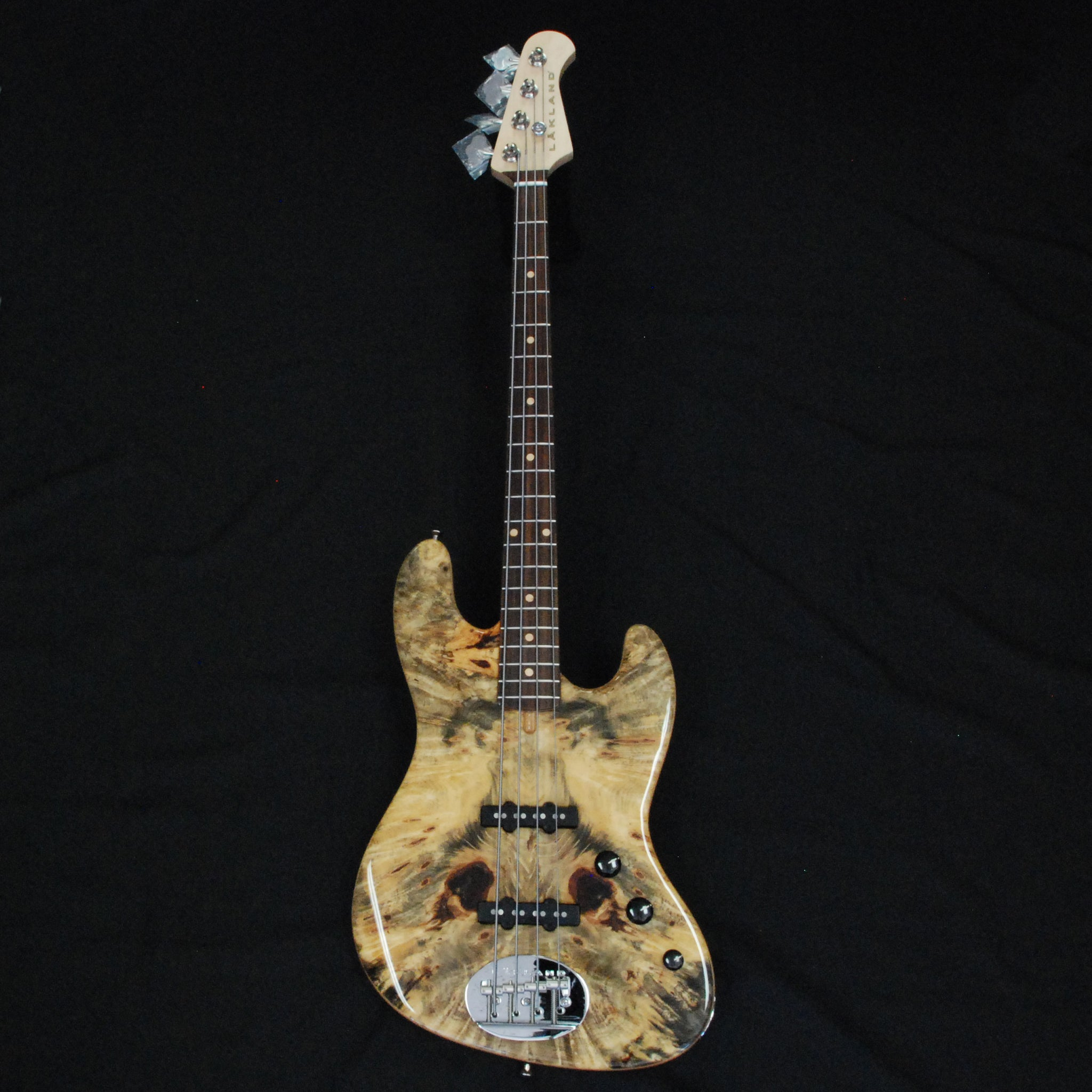 Shop online for Lakland USA Classic Series 44-60 Deluxe Buckeye Burl Maple 4 String Electric Jazz Bass Guitar today.  Now available for purchase from Midlothian Music of Orland Park, Illinois, USA