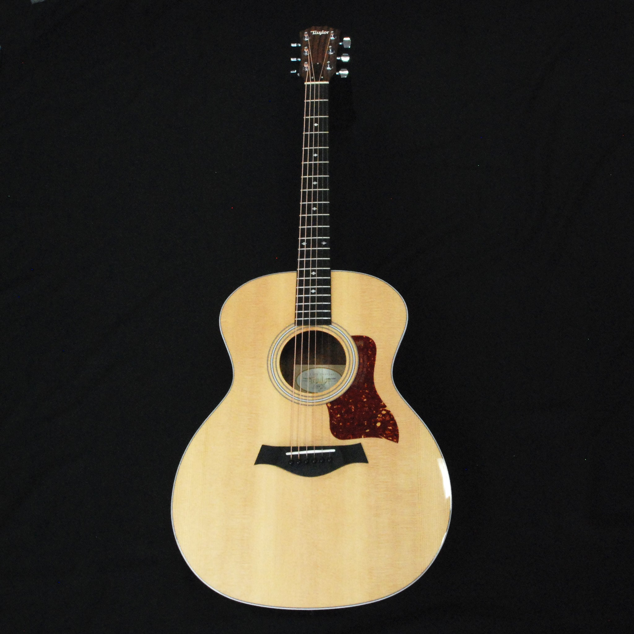 Shop online for Taylor 214e DLX Grand Auditorium Acoustic/Electric Guitar today.  Now available for purchase from Midlothian Music of Orland Park, Illinois, USA