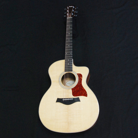 Shop online for Taylor 214ce-K DLX Deluxe Grand Auditorium Cutaway Acoustic/Electric Guitar Koa today.  Now available for purchase from Midlothian Music of Orland Park, Illinois, USA