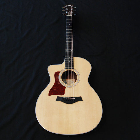 Shop online for Taylor 214ce DLX Deluxe Left Hand Grand Auditorium Acoustic/Electric Guitar today.  Now available for purchase from Midlothian Music of Orland Park, Illinois, USA