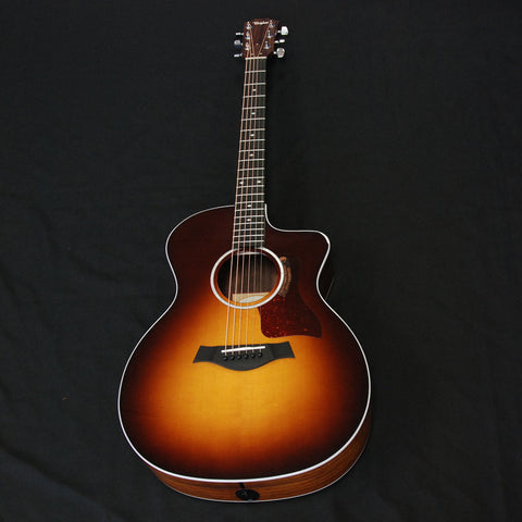 Shop online for Taylor 214ce-SB DLX Deluxe Grand Auditorium Cutaway Acoustic/Electric Guitar Tobacco Sunburst today.  Now available for purchase from Midlothian Music of Orland Park, Illinois, USA