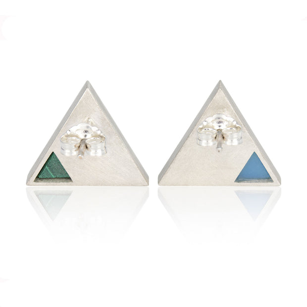 Back view of triangle shaped stud earrings with green malachite smaller triangular inlay on one stud and light blue jadeite triangular inlay on the other stud. Metal is silver
