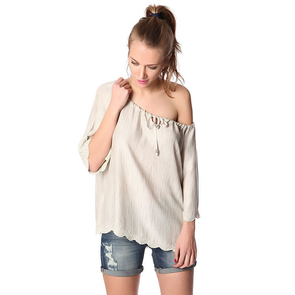 Beige off shoulder top in textured fabric with embroidered detail