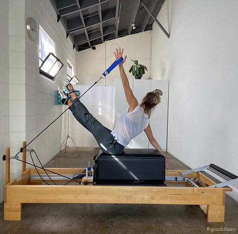 Alyson Mattoon doing a Pilates Teaser with Good Citizen straps.