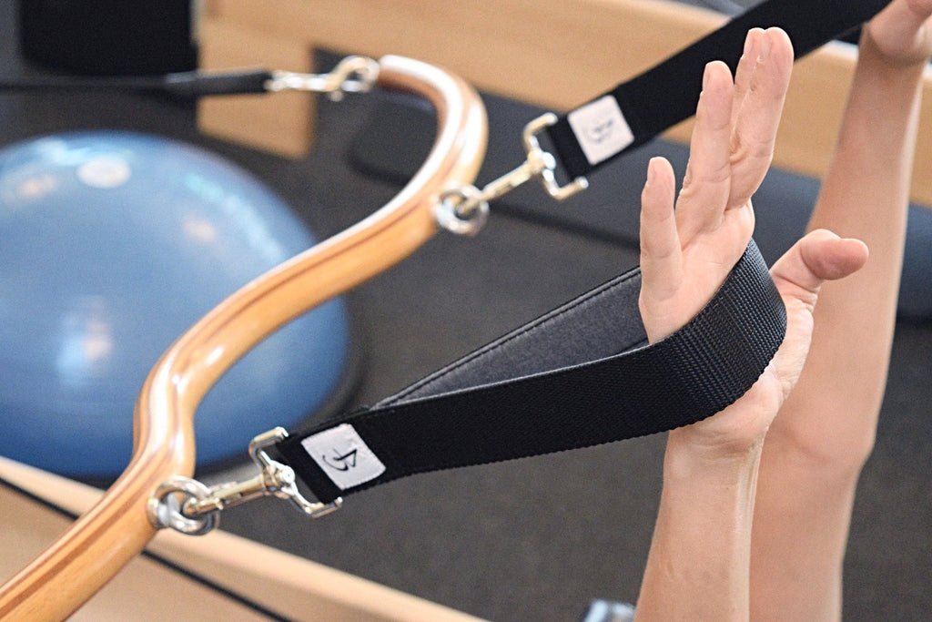 Black and grey Arcus Bar  Pilates Loops Pilates Straps
