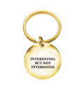 Interesting Not Interested Circle Keychain - Metal Marvels - Bold mantras for bold women.
