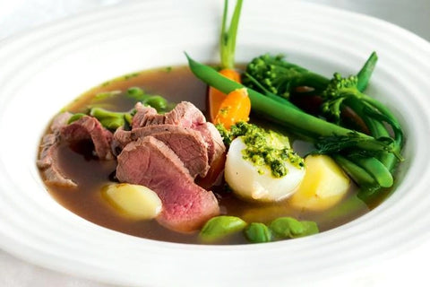 Poached lamb with spring vegetables