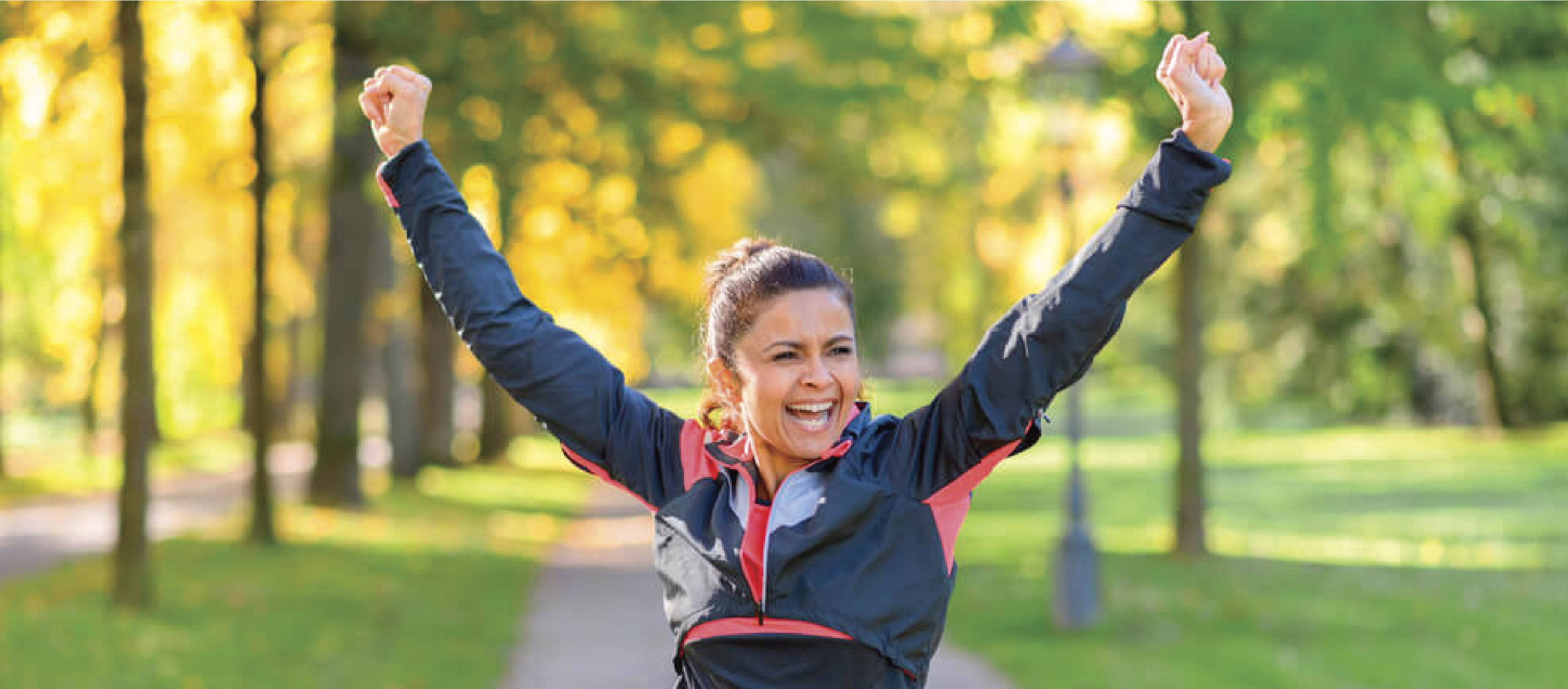 Happy woman doing exercise in the park