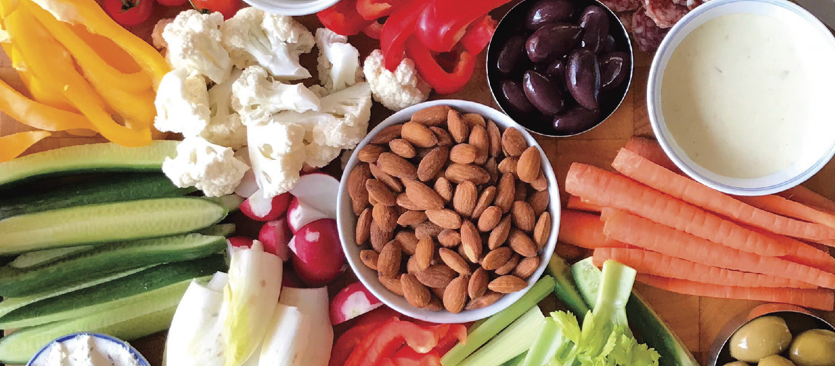 Different healthy snacks like nuts and carrots