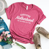 Surviving Motherhood One Meltdown at a Time Short Sleeve Graphic Tee