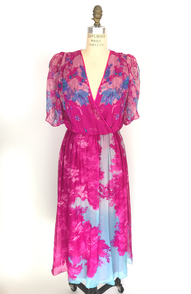 Vintage Hanae Mori 100% silk dress with beautiful floral print. Flirty split flutter sleeve and lined throughout body. Waist is elastic and wearable on many body sizes. Tag reads size 4.