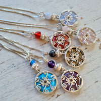 Tiny Venus necklaces