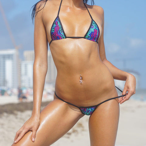 Sexy Model on the beach in Bitsy's Bikinis Micro Bikini G-String - Jewel Snakeskin - Black String