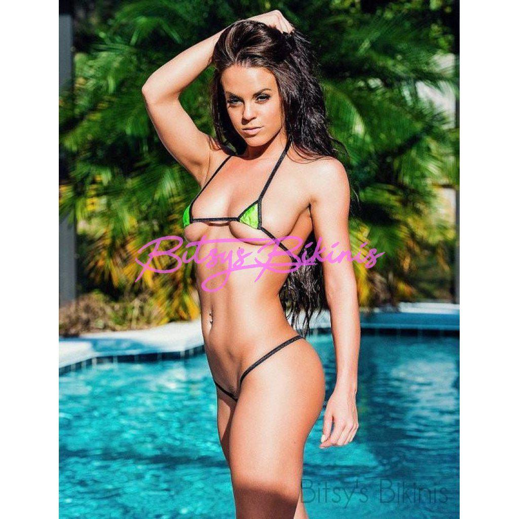 Woman in Bitsy's Bikinis Extreme Micro Bikini - Euro - Solid Green Lycra with Black String
