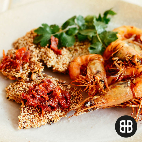 BANTING BLVD Seed Crackers with grilled coconut prawns and tomato tapenade