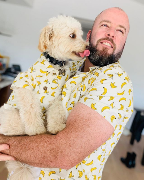 Chris Sullivan from This Is Us with his dog in matching shirts by Dog Threads
