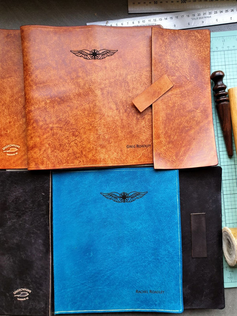 Sparrowhawk Leather work in progress laser engraved hand dyed pilot logbook covers